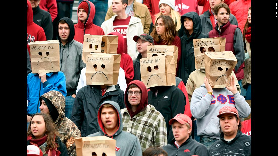 Arkansas fans wear paper bags over their heads in the final seconds of a football loss to Mississippi State on Saturday, November 18. Arkansas' record dropped to 4-7 on the season.