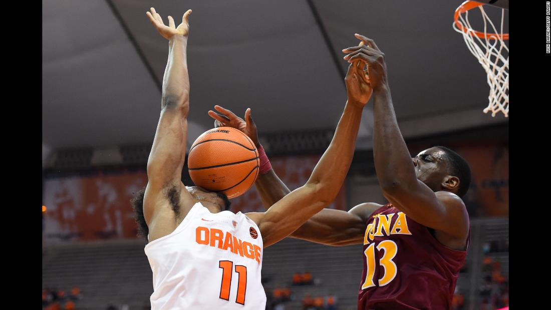 Iona's TK Edogi blocks a shot onto Oshae Brissett's face during a college basketball game at Syracuse on Tuesday, November 14.