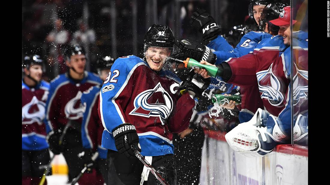 Colorado's Gabriel Landeskog is sprayed by teammate Jonathan Bernier after scoring a hat trick against Washington on Thursday, November 16.