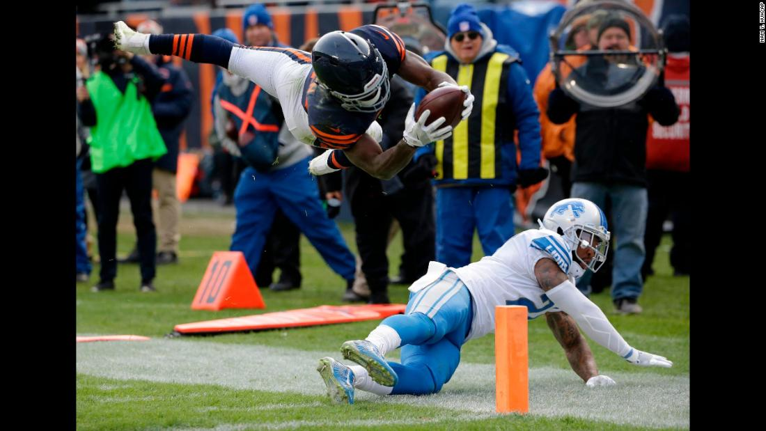 Chicago running back Tarik Cohen leaps over Detroit safety Glover Quin to score a touchdown on Sunday, November 19. It tied the game at 24 late in the fourth quarter, but Detroit prevailed after a 52-yard field goal by Matt Prater.
