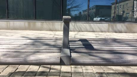 An armrest on a bench in Toronto, Canada.