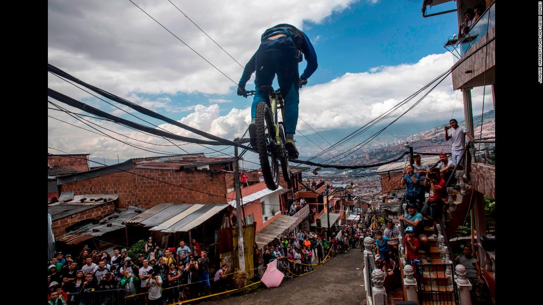 A cyclist races downhill during a bike race in Medellin, Colombia, on Sunday, November 19.