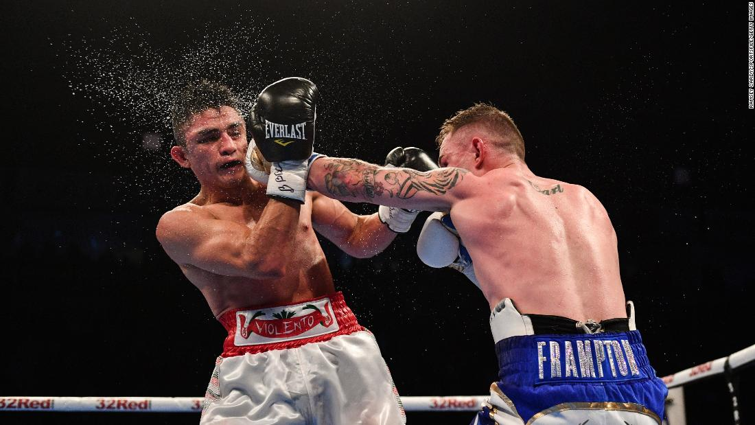 Carl Frampton punches Horacio Garcia during their featherweight bout in Belfast, Northern Ireland, on Saturday, November 18. Frampton won by unanimous decision.