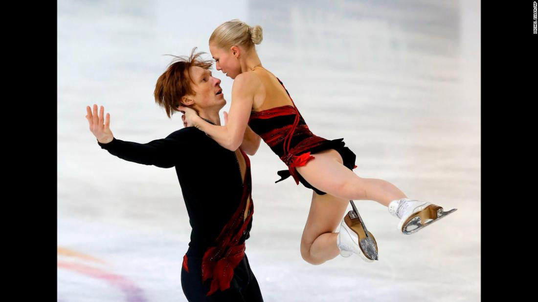 Russian figure skaters Vladimir Morozov and Evgenia Tarasova perform their short program during the Grand Prix event in Grenoble, France, on Friday, November 17. They won gold in the pairs competition.