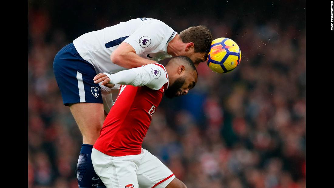 Tottenham's Jan Vertonghen, top, and Arsenal's Alexandre Lacazette compete for a header during a Premier League match in London on Saturday, November 18. Arsenal won the rivalry match 2-0.