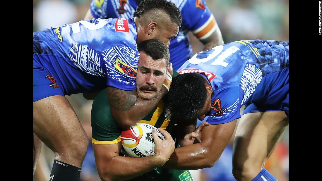 Australian's Reagan Campbell-Gillard is tackled by Samoa players during the quarterfinals of the Rugby League World Cup on Friday, November 17.