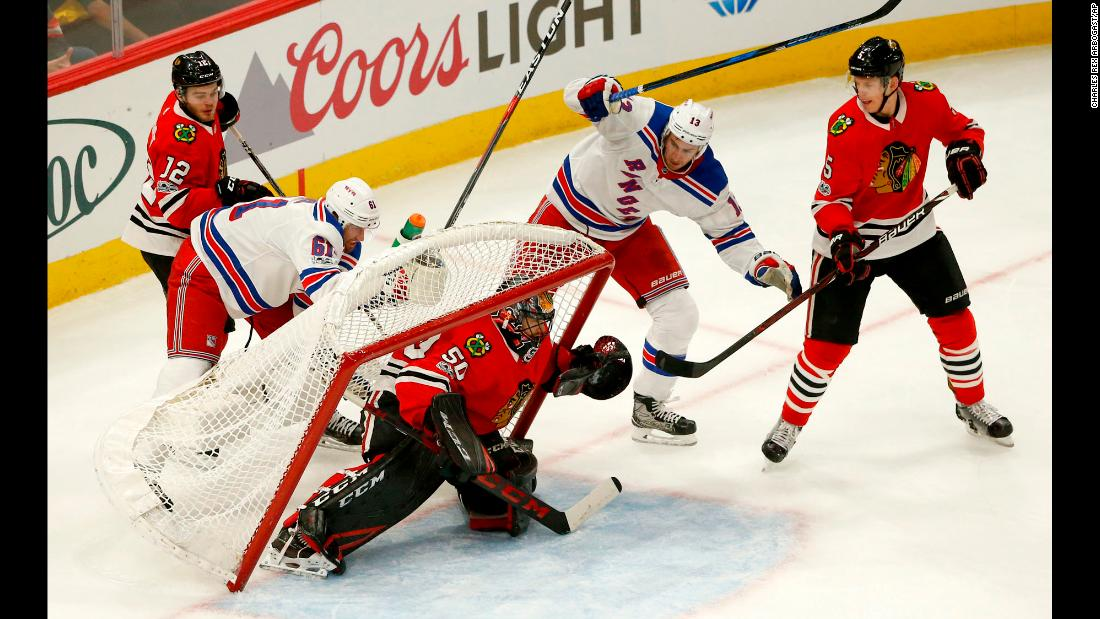 The net almost falls onto Chicago goalie Corey Crawford during an NHL game against the New York Rangers on Wednesday, November 15.