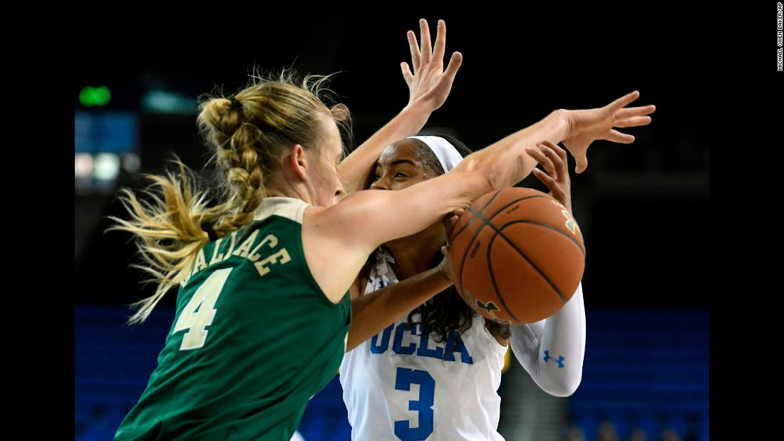 Baylor's Kristy Wallace fouls UCLA's Jordin Canada during a college basketball game in Los Angeles on Saturday, November 18.