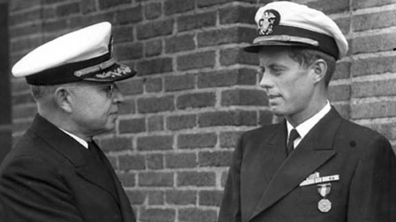 Despite being turned down by both the Army and Navy due to his bad back and other medical issues, Kennedy was able to get into the Navy with the help of his father, Joe Kennedy. In June 1944, he received the Navy and Marine Corps Medal for his bravery rescuing his men when his PT boat was struck by a Japanese destroyer. He towed one sailor for miles through the ocean to safety on land, aggravating a former back injury and setting the stage for a lifetime of back pain and surgeries.