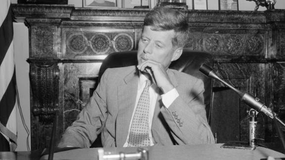 """In this image taken in his Senate office in January 1955, Kennedy is suffering from ramifications of his October 1954 spinal implant designed to fuse his spine and relieve his pain. An infection kept the incision from healing, creating an """"open, gaping ... hole,"""" according to his speechwriter. The implant was removed in February."""
