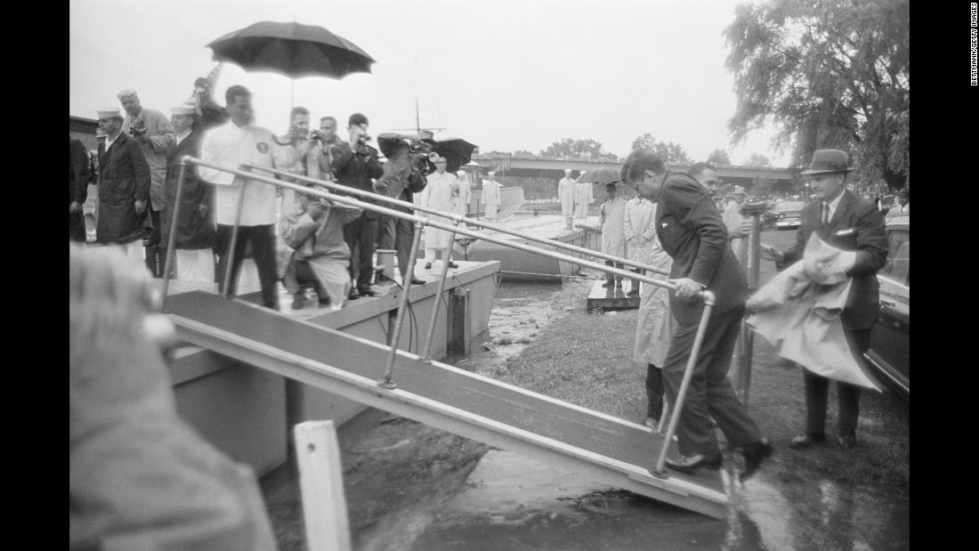 In June 1961, Kennedy still used crutches to walk from his car to a ramp to board the presidential yacht Honey Fitz for a cruise down the Potomac River with Japanese Prime Minister Hayato Ikeda. When he reached the ramp, he discarded the crutches and used the railings to support himself.