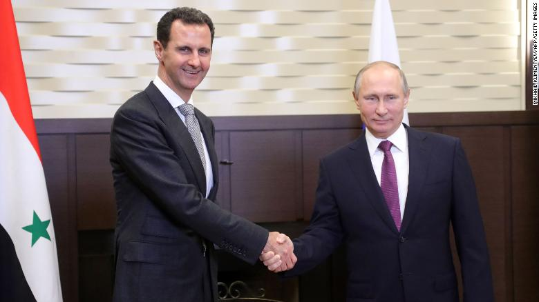 Russia's President Vladimir Putin, right, shakes hands with his Syrian counterpart Bashar al-Assad during a meeting in Sochi, Russia, in November.