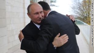 Russia's President Vladimir Putin embraces his Syrian counterpart Bashar al-Assad during a meeting in Sochi.
