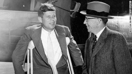 BOSTON, MA - OCTOBER 7: Democratic gubernatorial candidate Robert F. Murphy, right, and U.S. Senator John F. Kennedy arrive at Logan International Airport in Boston from Hyannis prior to a television appearance on Oct. 7, 1954. Senator Kennedy was on crutches as a result of a back injury. (Photo by William Ennis/The Boston Globe via Getty Images)