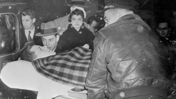 John F. Kennedy and wife Jackie leaving the hospital two months after his 1954 spinal fusion.