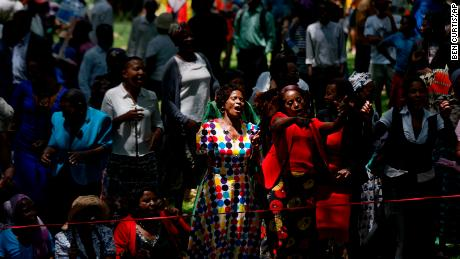 "Zimbabweans gather to pray for the country in a park opposite the parliament building in downtown Harare, Zimbabwe Tuesday, Nov. 21, 2017. Zimbabwean President Robert Mugabe should acknowledge the nation's ""insatiable desire"" for a leadership change and resign immediately, the recently fired vice president and likely successor to the 93-year-old leader said Tuesday. (AP Photo/Ben Curtis)"