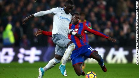 Everton's Oumar Niasse of Everton is tackled by Crystal Palace's Jeffrey Schlupp.