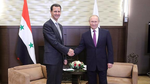 Putin (right) praised Assad for his work fighting ISIS.