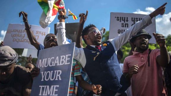 Protesters call for Mugabe's impeachment near the Parliament building in Harare on November 21.