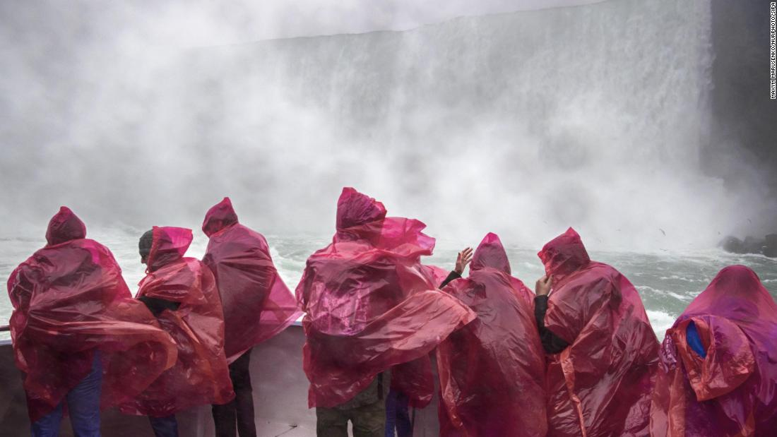 <strong>Niagara Falls, Canada: </strong>Tourists put their rain ponchos to the test while riding a ferry on the Ontario side of Niagara Falls on an October day in 2017.