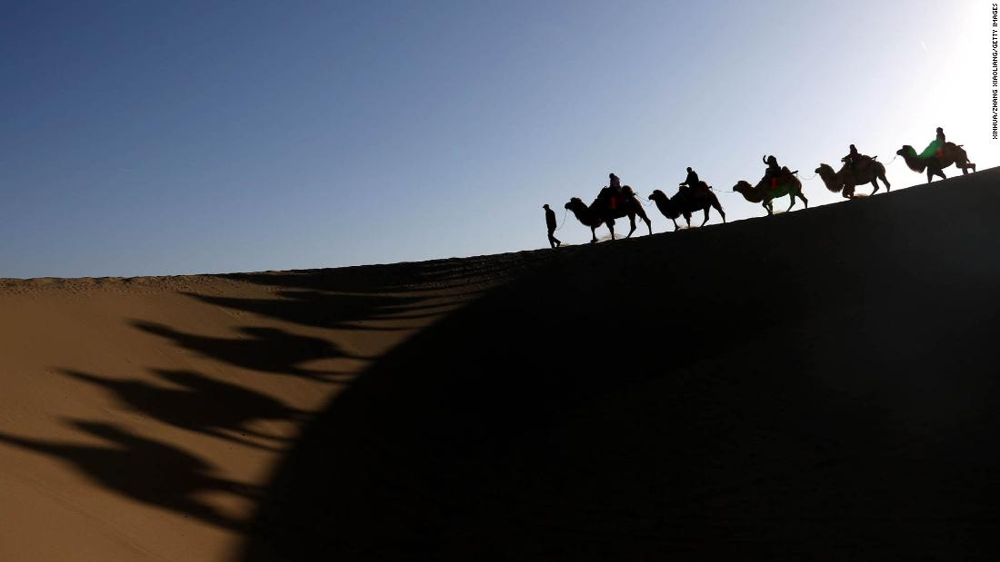 <strong>Dunhuang, China: </strong>A camel train moves through the Gobi Desert. Dunhuang, in northwest China's Gansu Province, is renowned for the beauty of the Singing Sand Dune (Mingsha Hill) and Crescent Spring scenic area. <br />