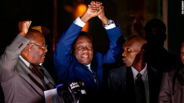 Zimbabwe's incoming leader Emmerson Mnangagwa greets supporters Wednesday in Harare.