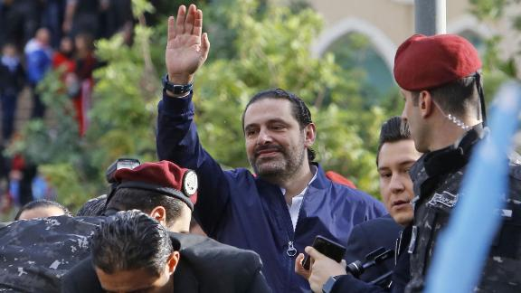 Lebanese Prime Minister Saad Hariri greets his supporters upon arriving at his home in Beirut in November.