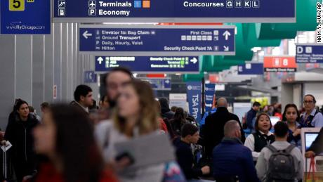 Passengers walk in Terminal 3 at O'Hare airport in Chicago, Tuesday, Nov. 21, 2017. Officials with the Illinois Department of Transportation and Illinois State Police say the ramped up enforcement efforts involving more than 150 law enforcement agencies will end early Monday. (AP Photo/Nam Y. Huh)