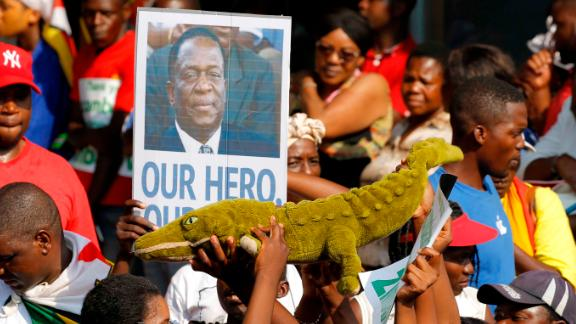 Supporters of Emmerson Mnangagwa hold up a toy to celebrate the man nicknamed