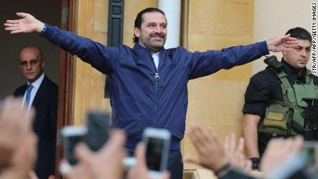 Lebanese prime minister Saad Hariri (L) greets his supporters upon his arrival at his home in Beirut on November 22, 2017. Hariri, back in Beirut after a mysterious odyssey that saw him announce his resignation in Saudi Arabia, told cheering supporters that he was staying. / AFP PHOTO / STR        (Photo credit should read STR/AFP/Getty Images)