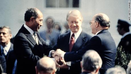 US President Jimmy Carter (C) congratulates Egyptian President Anwar al-Sadat (L) and Israeli Premier Menachem Begin (R) in March 1979 after the signature of their historic peace treaty.