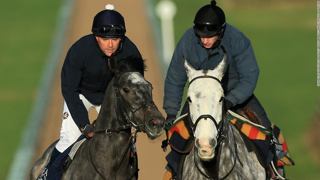 Owen (L) takes to the gallops to practice on board Calder Prince, the grey gelding he will will ride at Ascot.