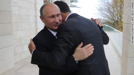Vladimir Putin embraces Bashar al-Assad during a meeting in Sochi, Russia in November, 2017.