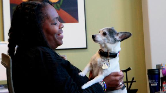 Keris Myrick (pictured in 2012) lives with her dog, Steinbeck, now 18 and a retired service dog.