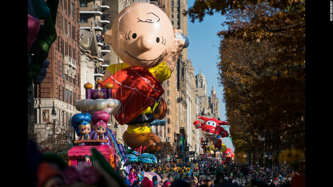 A Charlie Brown balloon moves down the parade route.