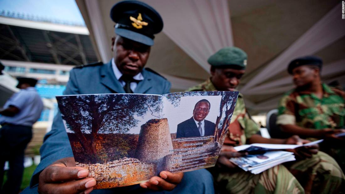 A Zimbabwe Air Force officer reads an inauguration program ahead of the ceremony.