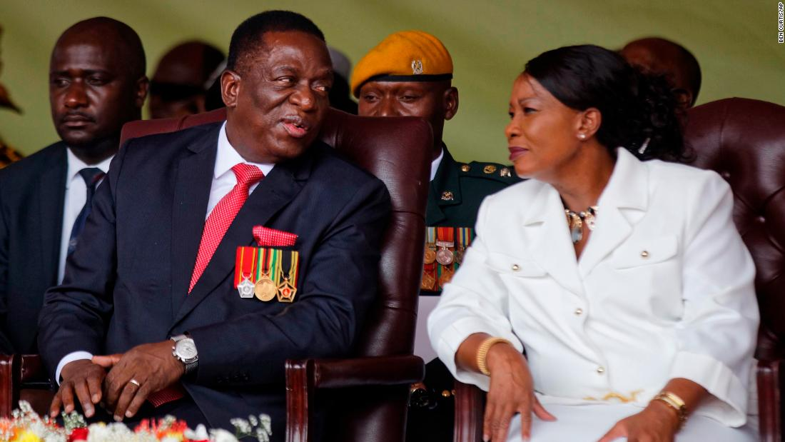 Mnangagwa sits with his wife, Auxillia, during the ceremony.