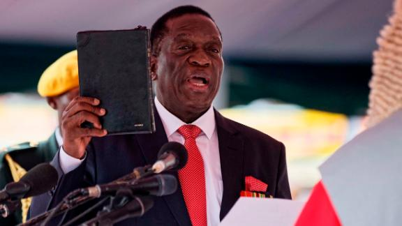 Emmerson Mnangagwa is sworn in on Friday, November 24, 2017, as interim President of Zimbabwe during a ceremony at the National Sports Stadium in the capital, Harare. Mnangagwa becomes leader of the country after former President Robert Mugabe
