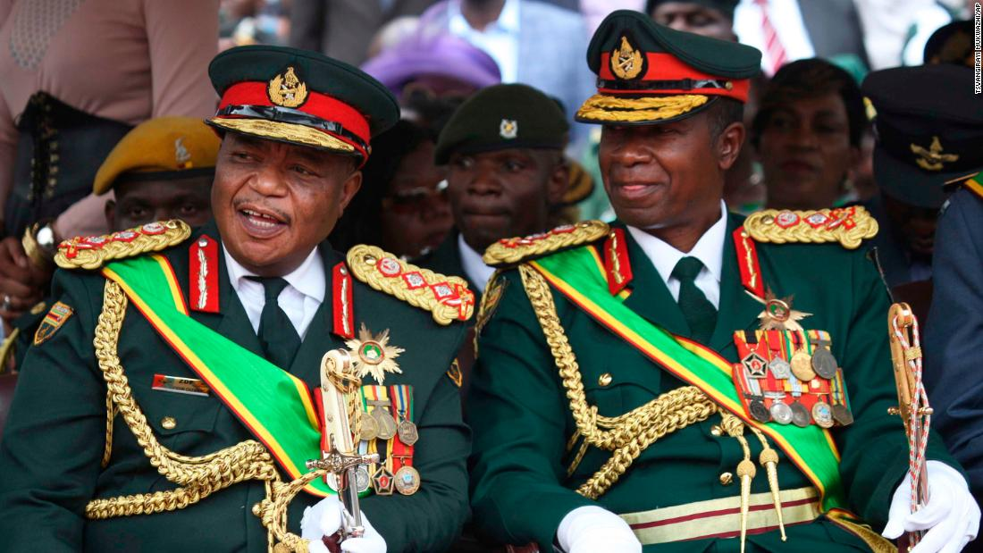Army Gen. Constantino Chiwenga, left, talks with Lt. Gen. Valerio Sibanda during the. inauguration.