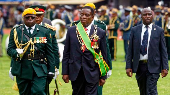 Mnangagwa inspects the military parade after being sworn in.