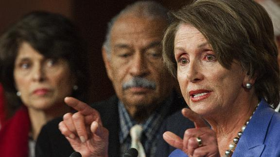 "US Representatives Lucille Roybal-Allard (L), D-CA, and John Conyers (C), D-MI, listen as US House Minority Leader Nancy Pelosi (R), D-CA, calls on Republicans to return to work because ""We Can't Wait"" on the payroll tax cut extension and unemployment insurance bills, January 5, 2012 on Capitol Hill. Democrats are highlighting the GOP's one year aniversary leading the House of Representatives without a jobs agenda."