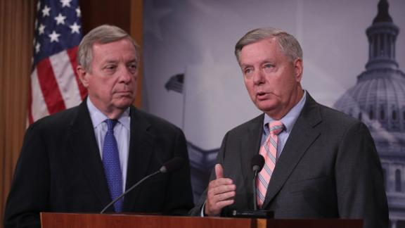 Sens. Dick Durbin, D-Illinois, and Lindsey Graham, R-South Carolina, speak during a news conference at the US Capitol September 5, 2017 in Washington.