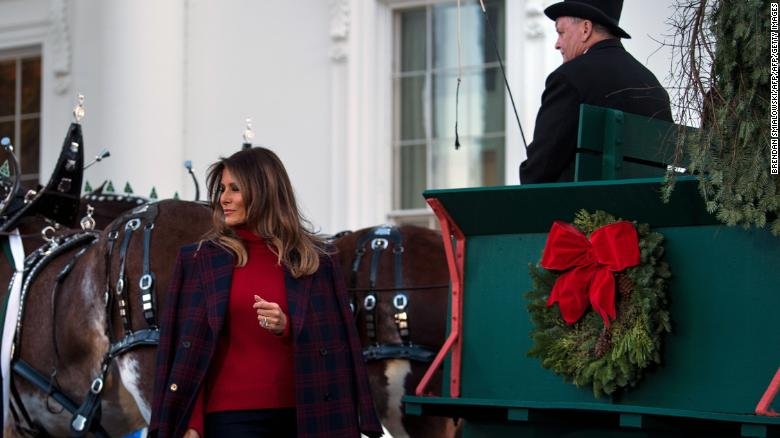 first lady melania trump arrives to receive a christmas tree during an event at the white