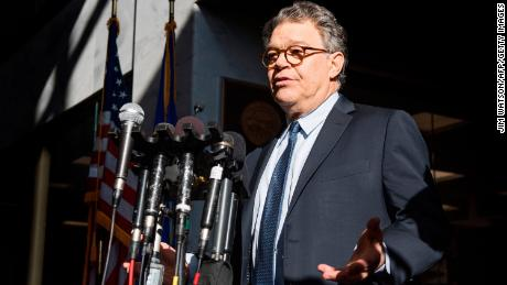 US Senator Al Franken, Democrat of Minnesota, speaks outside his office on Capitol Hill in Washington, DC, on November 27, 2017. Charges of sexual harassment and misconduct have shaken politicians of both parties raising pressure on people like US Representative John Conyers, Democrat of Michigan, and Franken to step down, and on an Alabama candidate for the US Senate, Republican Roy Moore, to drop out of that race. / AFP PHOTO / JIM WATSON        (Photo credit should read JIM WATSON/AFP/Getty Images)