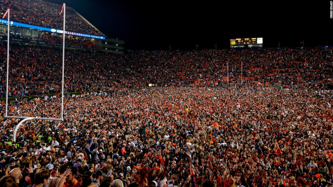 Auburn fans storm the field to celebrate the win over Alabama. The in-state rivalry, better known as the Iron Bowl, is one of college football's most intense matchups.