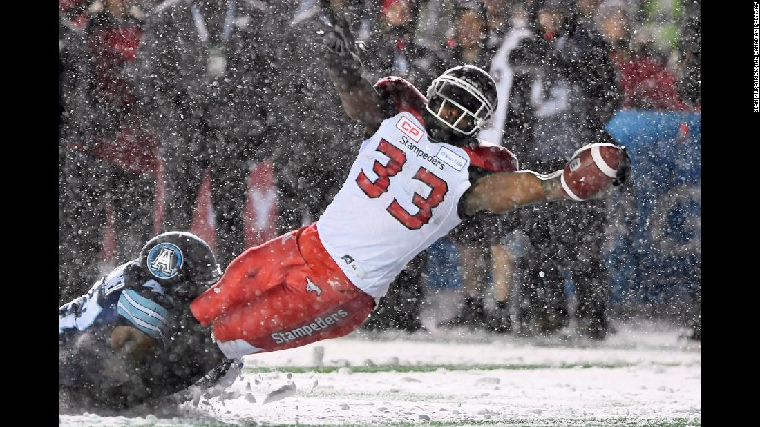 Toronto's Terrance Plummer tackles Calgary's Jerome Messam in the Grey Cup, the championship game of the Canadian Football League, on Sunday, November 26. Toronto won 27-24 for its league-record 17th title.