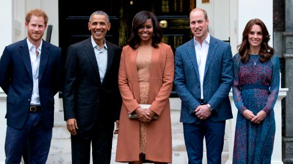 Harry, William and Catherine take a photo with US President Barack Obama and first lady Michelle Obama after the Obamas arrived at Kensington Palace in 2016.