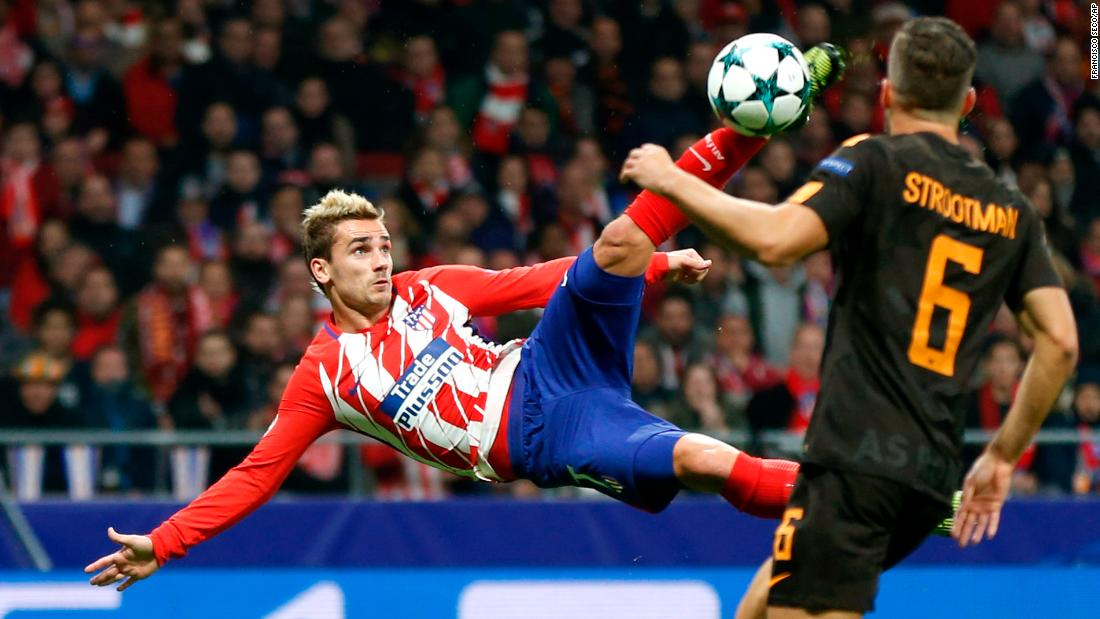 Atletico Madrid star Antoine Griezmann volleys the ball to score a spectacular goal in the Champions League match against Roma on Wednesday, November 22. Atletico won 2-0 over their Italian opponents.