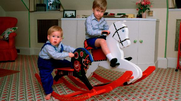 Harry, left, and William play on rocking horses at Kensington Palace.