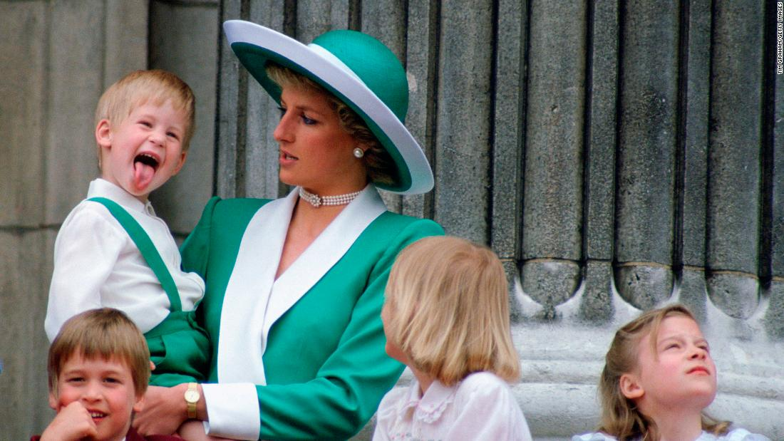 Harry sticks his tongue out, much to the surprise of his mother, at Buckingham Palace in 1988.